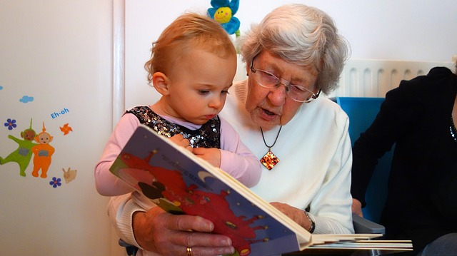 Visually impaired senior reading to grandchild